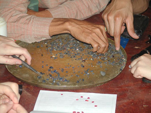 Rubie and sapphires, mine run selection, Pailin cambodia, end of the day, all production. Yannick Mandaba, Nah Severs.